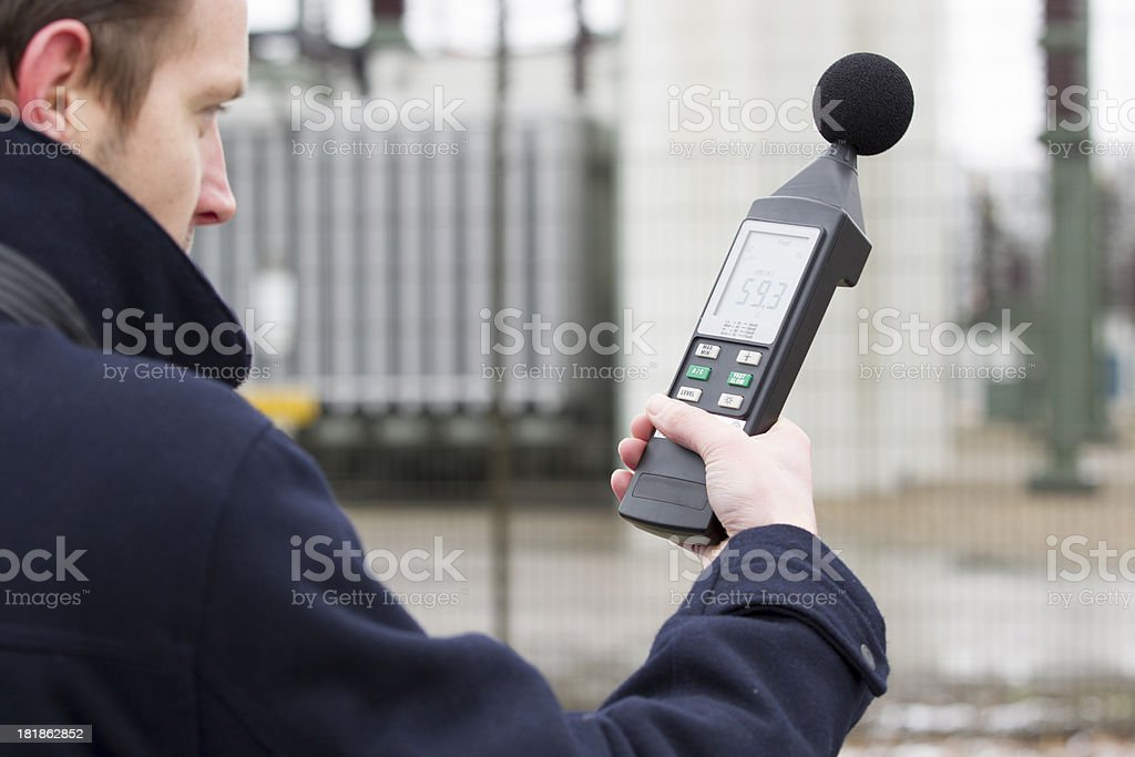 Sound pollution, man near industry stock photo
