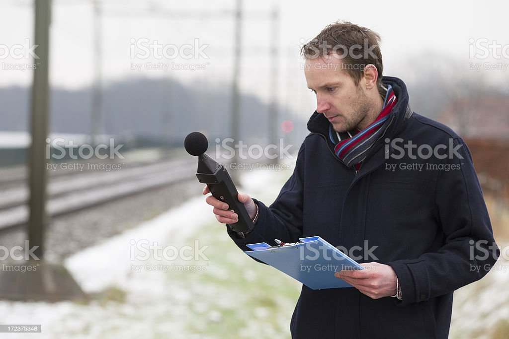 'Sound pollution, man near railroad track' stock photo