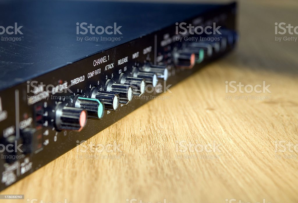Close up shot of sound compressor at sound recording studio