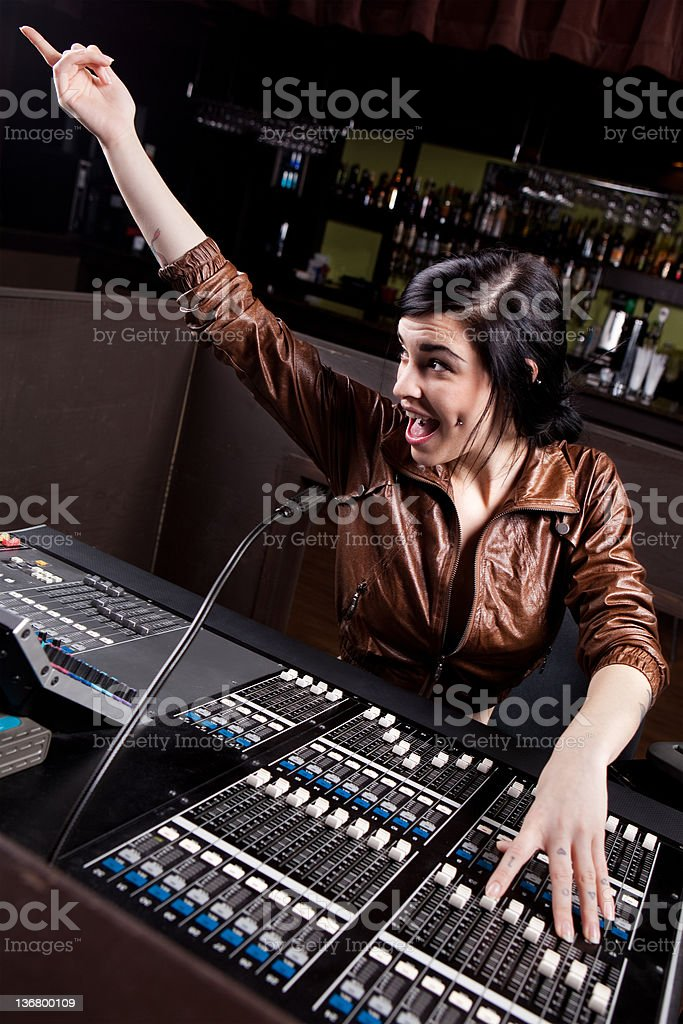 Soundboard technician doing a sound check stock photo