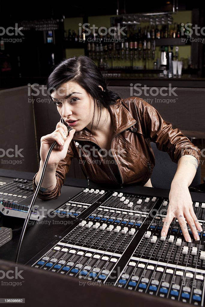 A soundboard technician performing a sound check stock photo