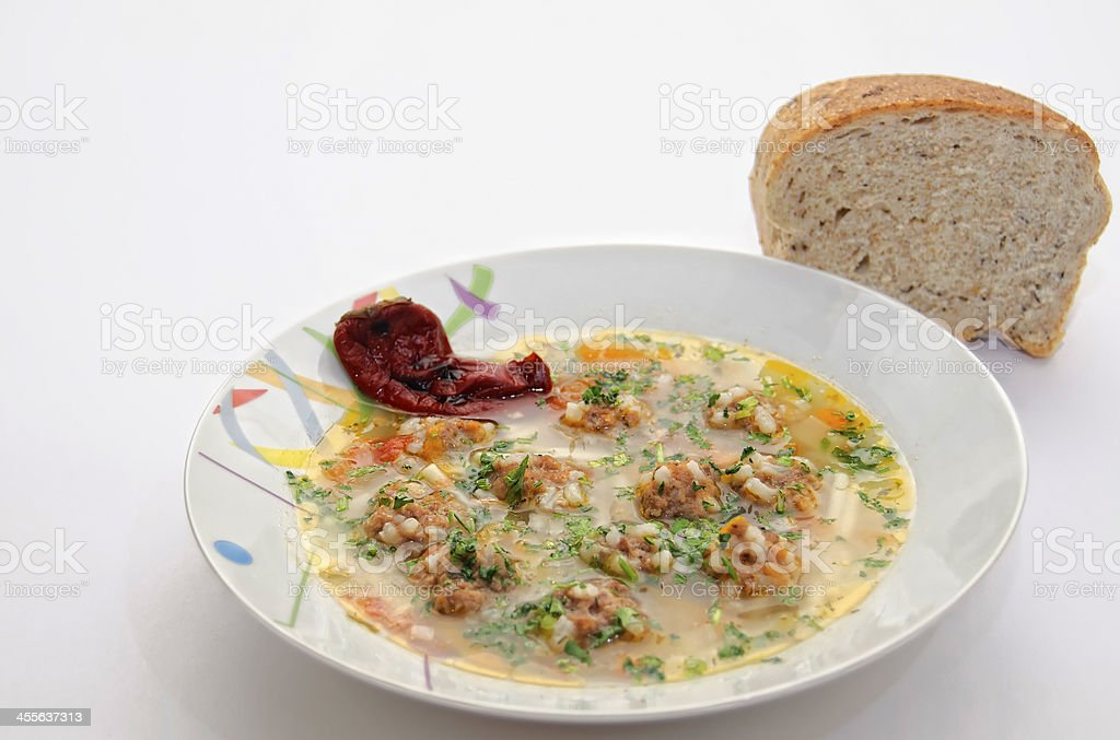 Soup and a slice of bread royalty-free stock photo