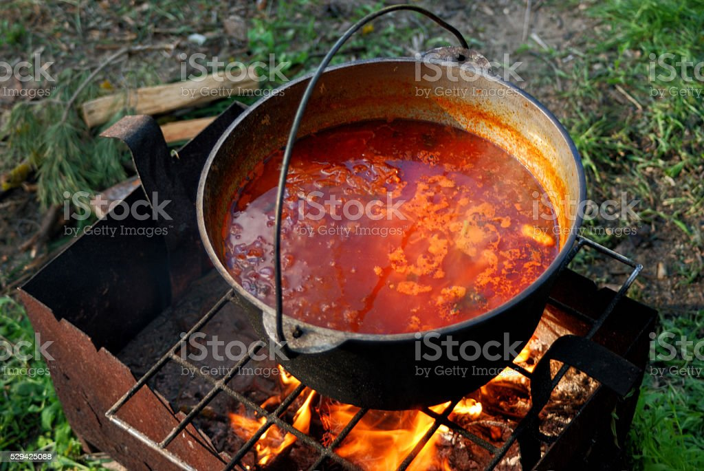 soup cooked on an open fire stock photo