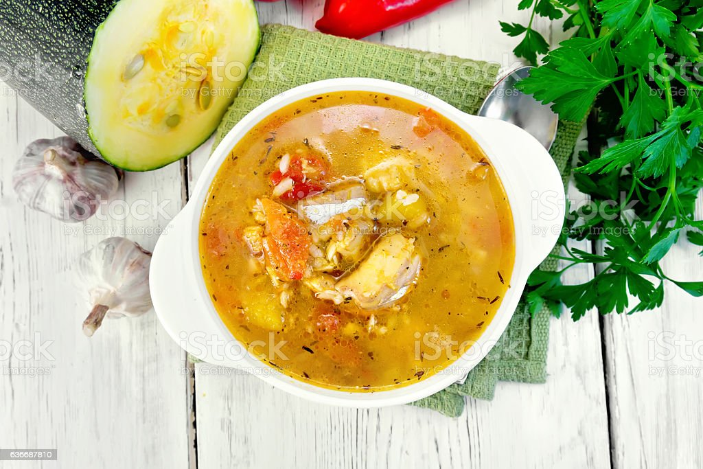 Soup fish with zucchini and peppers on board top stock photo