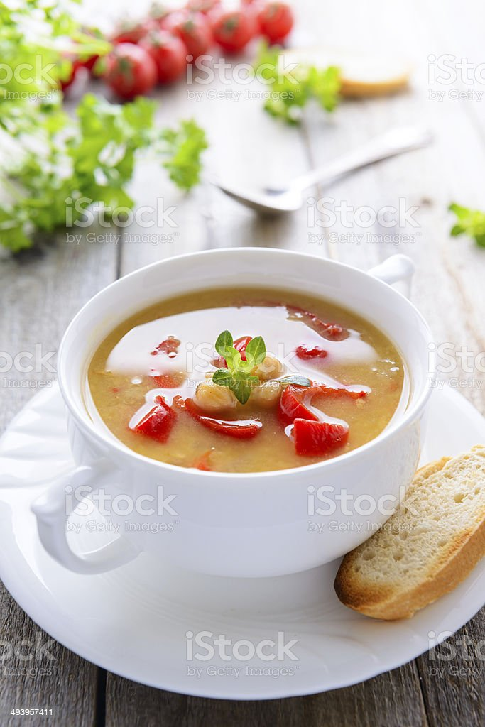 Soup from chickpeas and sweet pepers stock photo