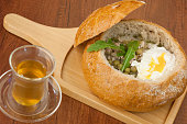 Soup in a bread bowl on the board