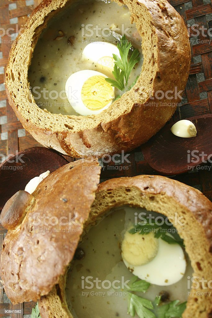 Soup in a fresh bread-bowl royalty-free stock photo
