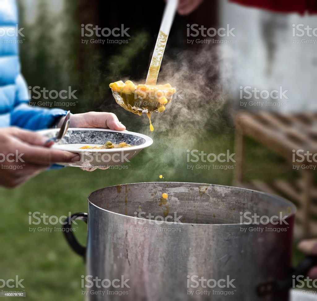 Soup kitchen serving poor people stock photo