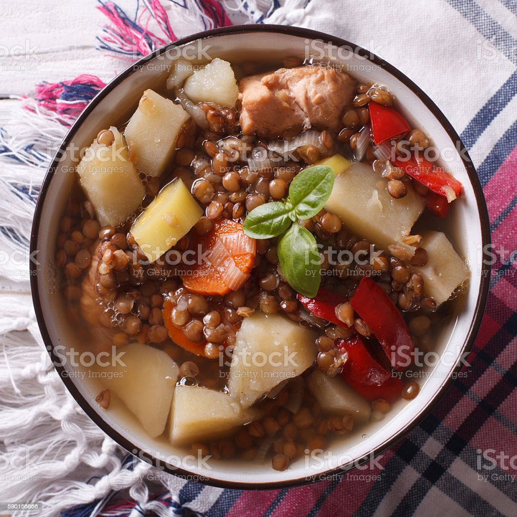 soup of brown lentils with chicken and vegetables. top view stock photo