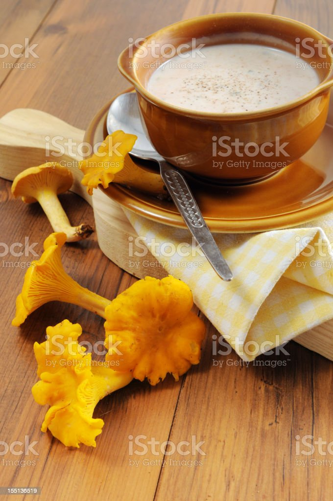 soup of golden chanterelle mushroom - Pfifferlingssuppe (Cantharellus cibarius) stock photo