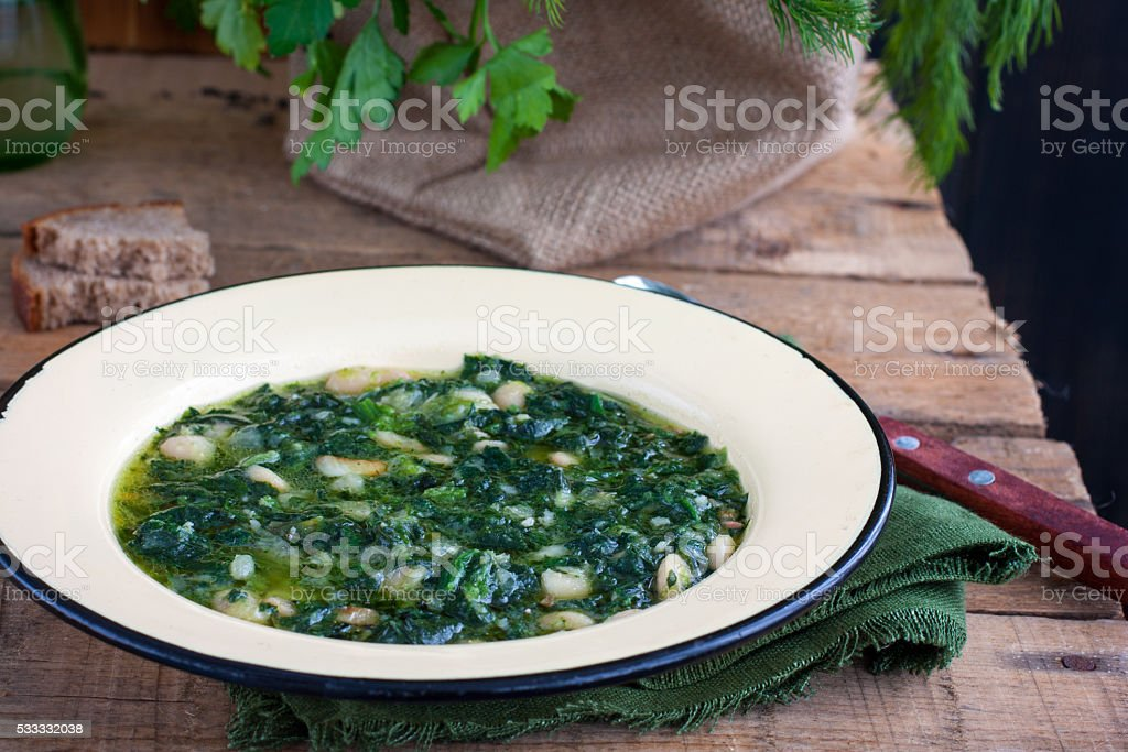 soup of spinach and peas stock photo