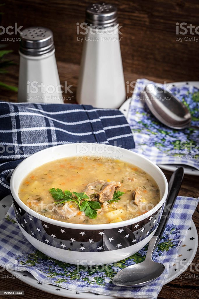 Soup with barley and chicken gizzards. stock photo