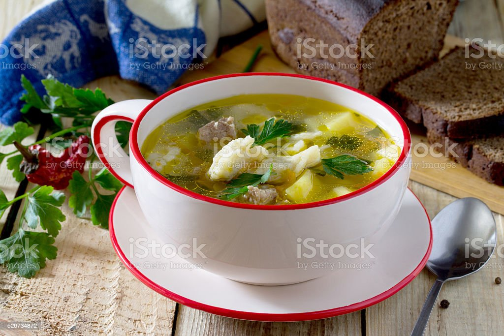 Soup with dumplings and meat stock photo