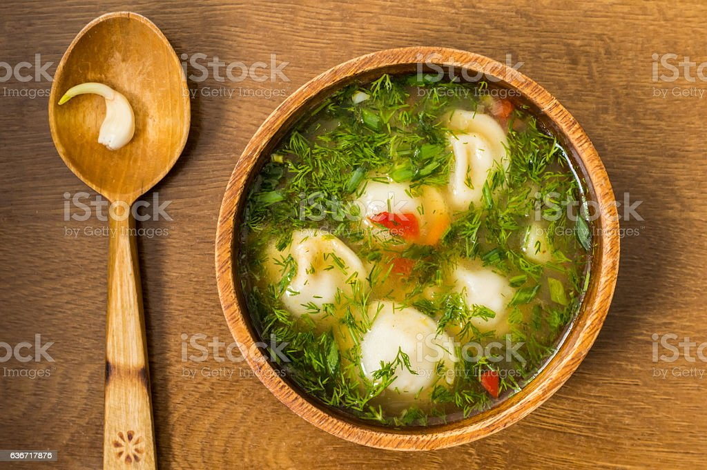 Soup with dumplings. Wooden table. Top view. Close-up stock photo