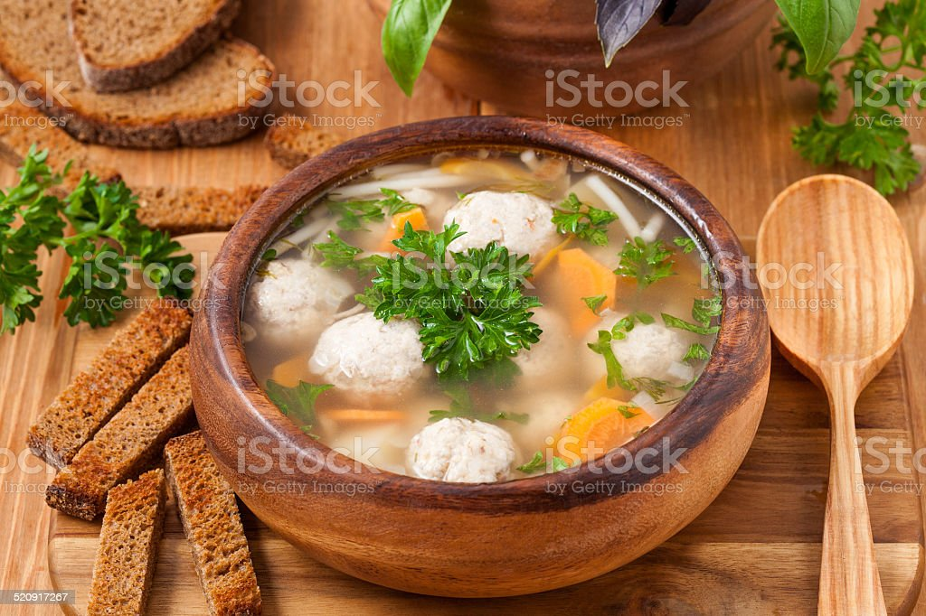 Soup with meatballs and vegetables stock photo