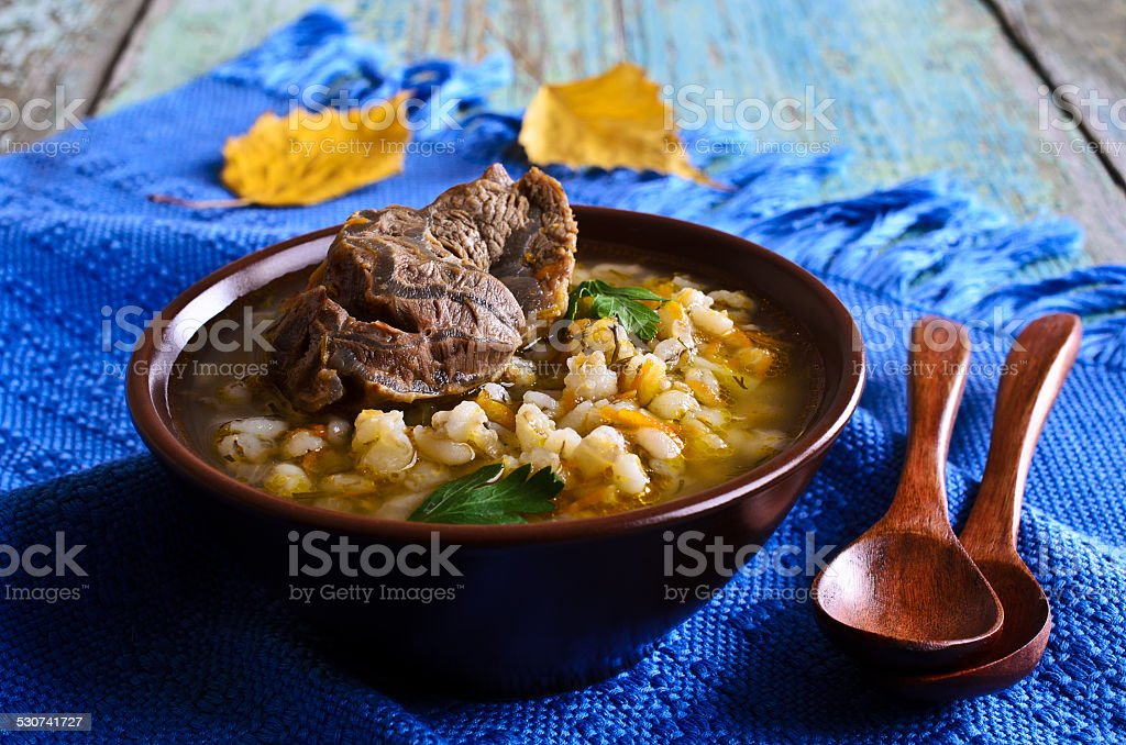 Soup with pearl barley and meat stock photo