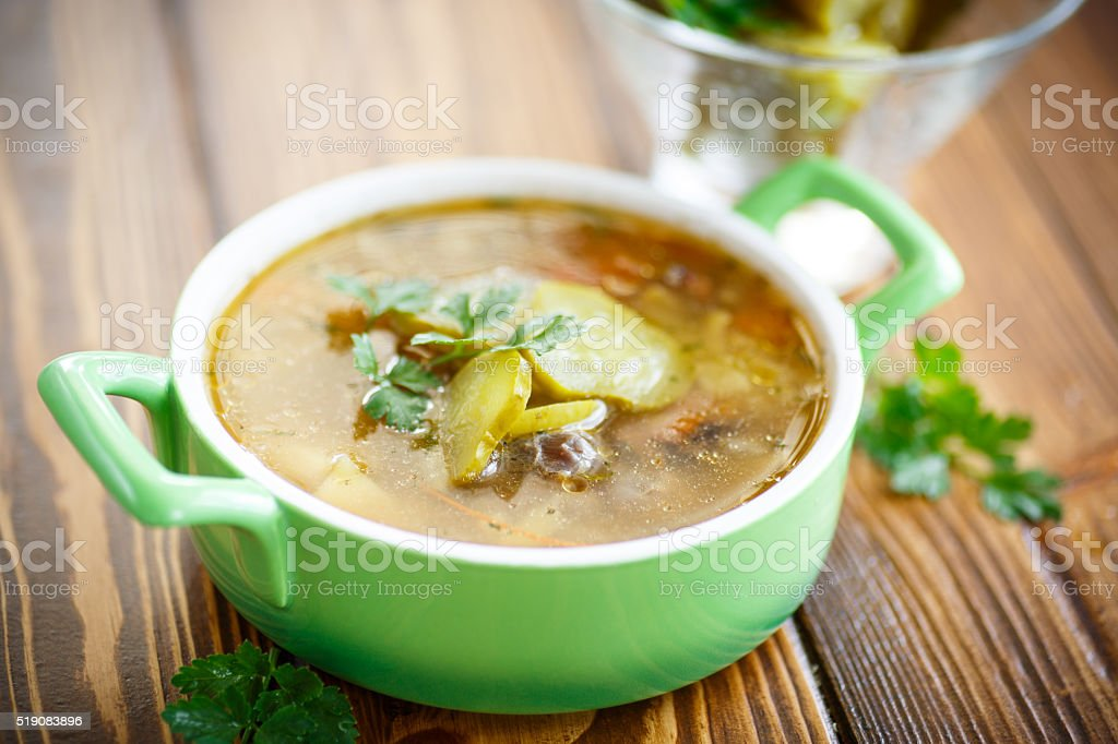 soup with pickled cucumbers on the plate stock photo