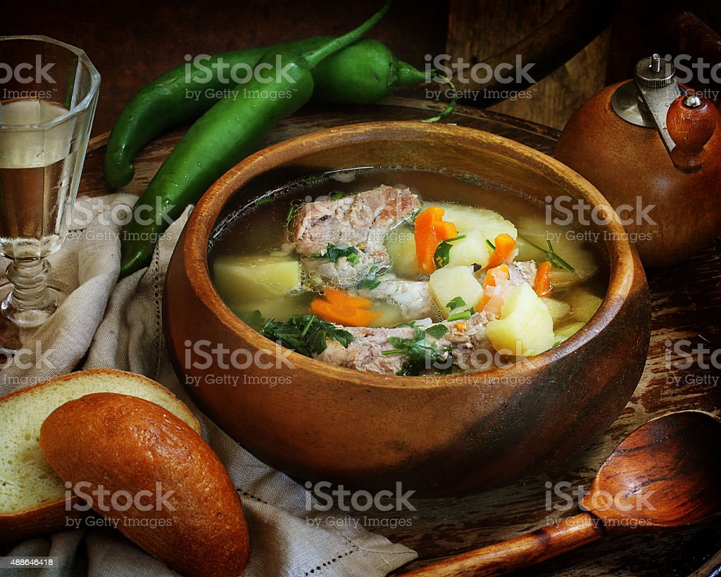 Soup with pork ribs, vegetables and vodka stock photo