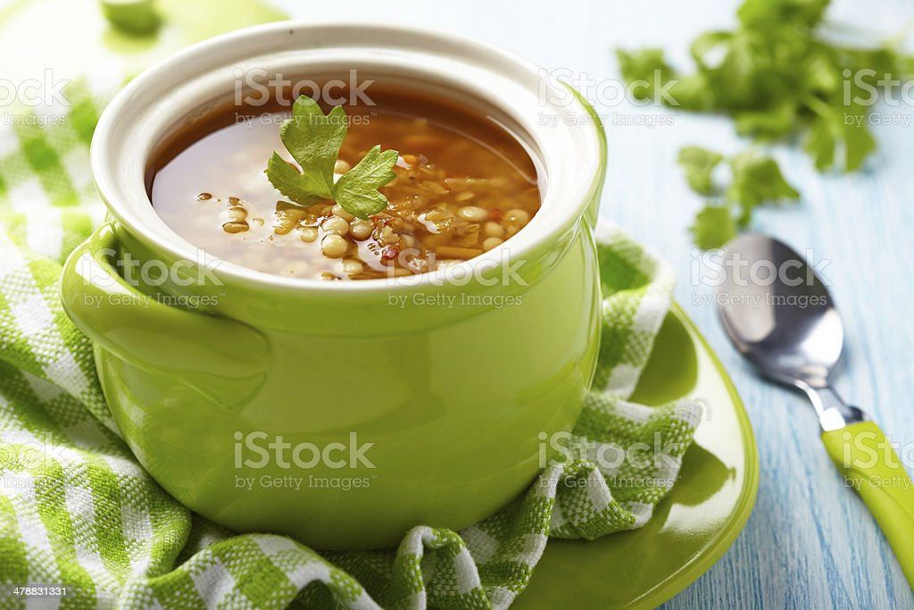 Soup with red lentil, pasta and vegetables stock photo