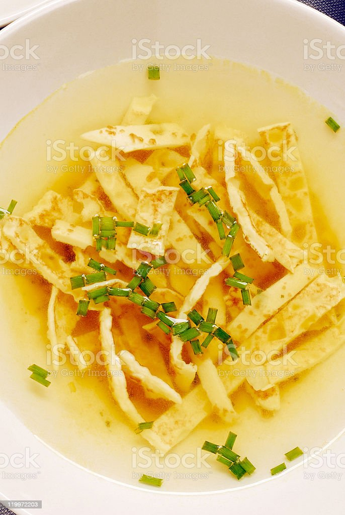 soup with strips of pancake stock photo