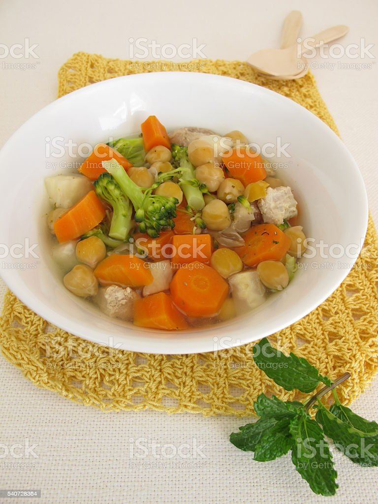 Soup with vegetables and chickpeas stock photo