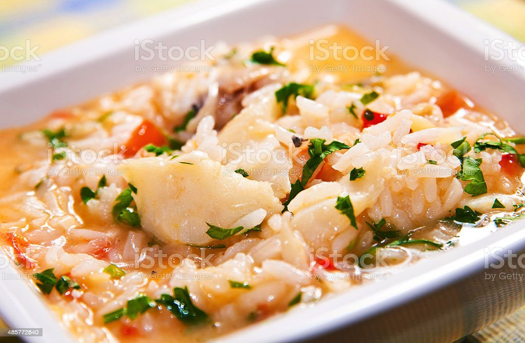 Soup-like rice with codfish stock photo
