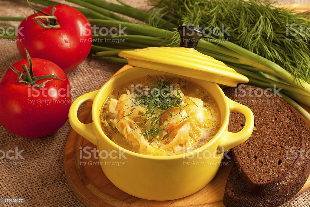 Sour cabbage soup with rye bread royalty-free stock photo