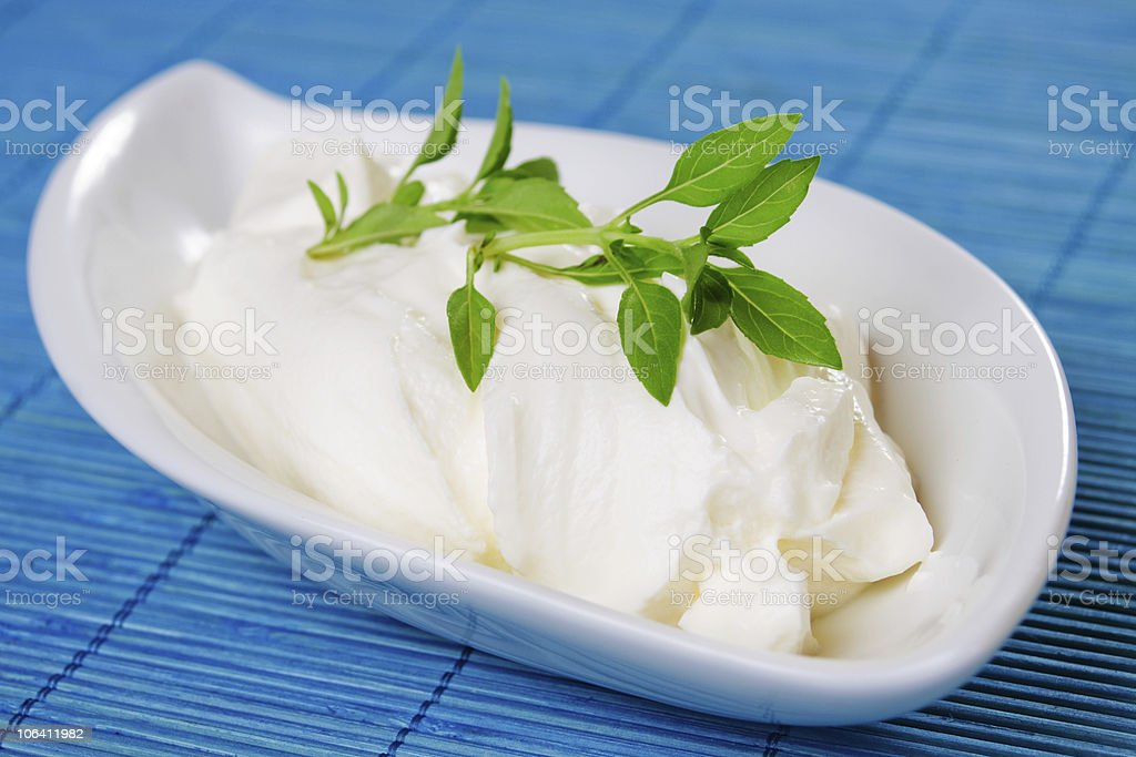 Sour cream with basil stock photo