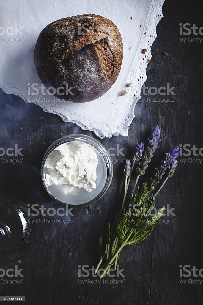 Sour dough bread and smoked lavender butter stock photo