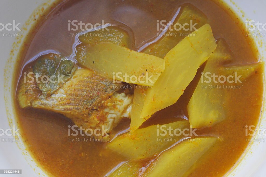 Sour soup with fish and papaya stock photo