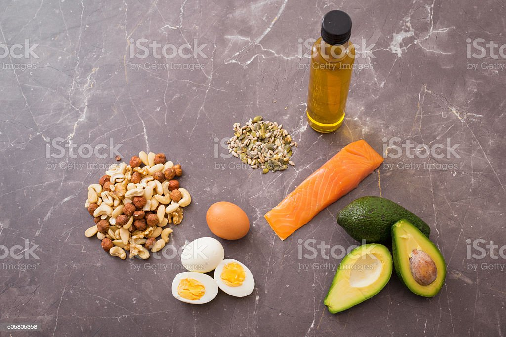 Source of protein and fats on kitchen table stock photo