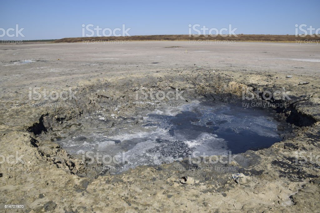 Source vents mud at bottom of a dried-up salt lake stock photo