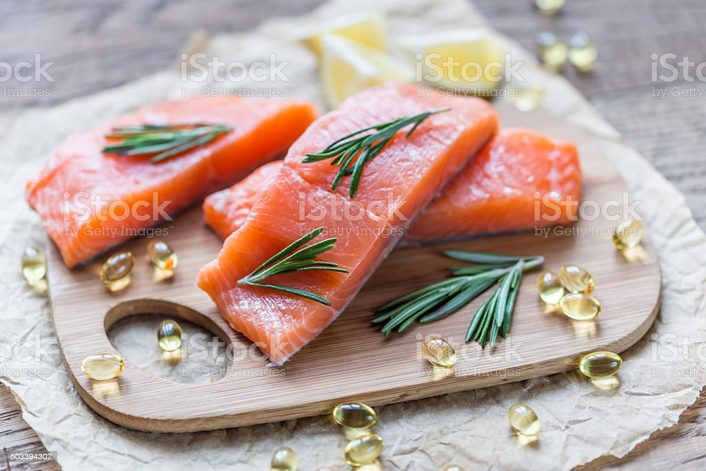 Sources of Omega-3 acid (salmon and Omega-3 pills) stock photo