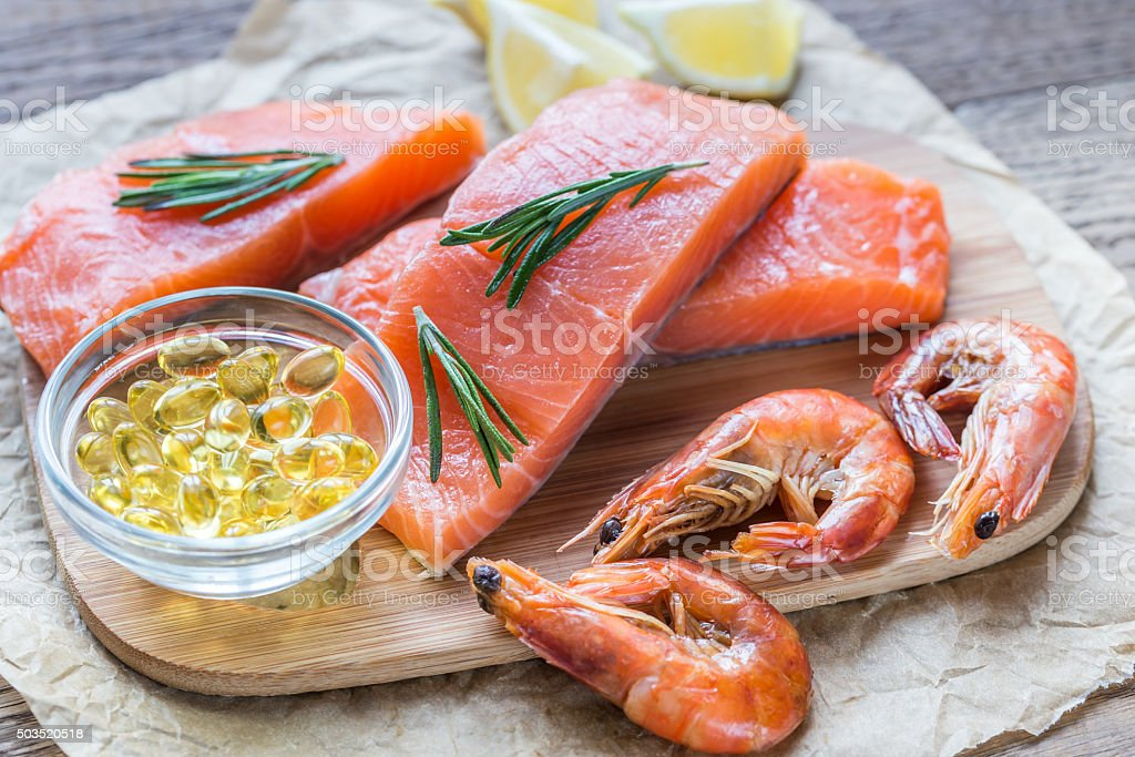 Sources of Omega-3 acid (salmon, shrimps, Omega-3 pills) stock photo