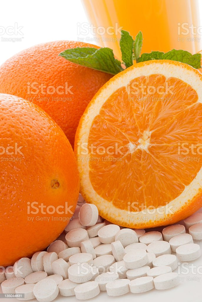 Sources of Vitamin C includes oranges orange juice and pills stock photo