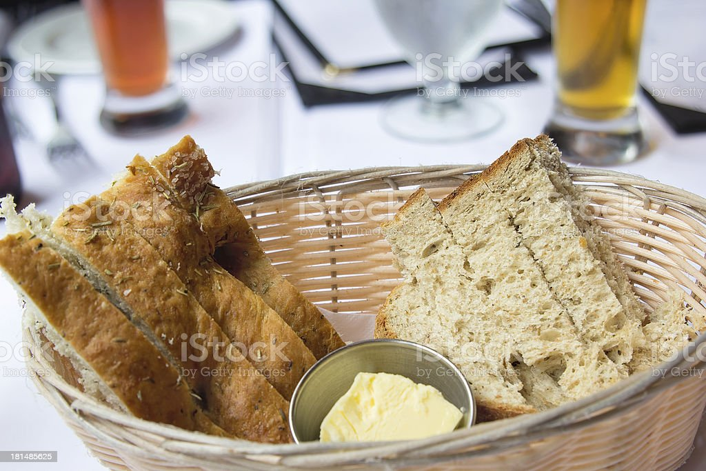 Sourdough and Herb Bread in Basket stock photo