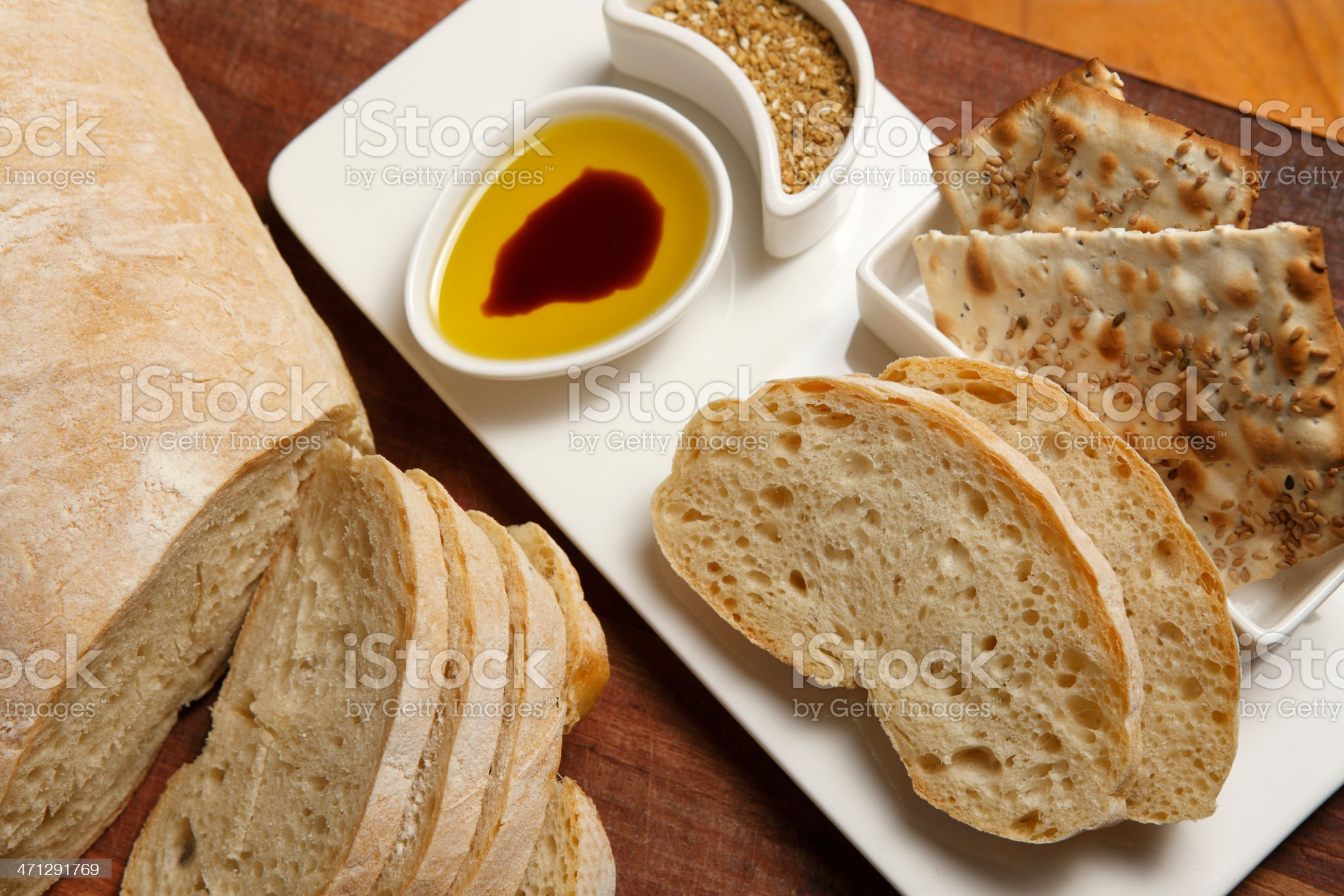 Sourdough bread, dips and crackers royalty-free stock photo