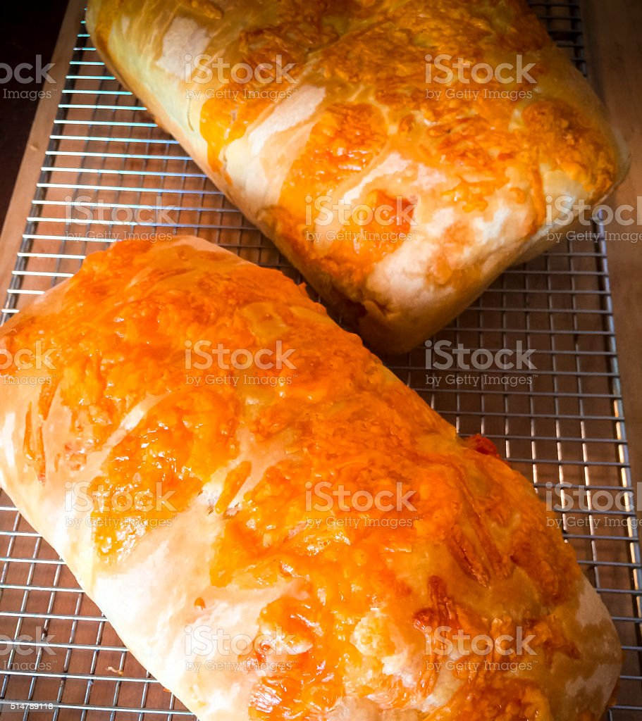 Sourdough Cheese Bread Cooling On A Rack stock photo