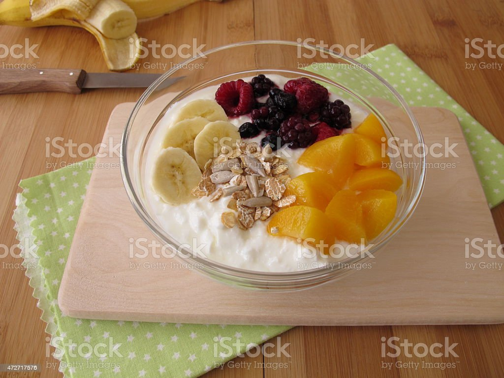 Soured milk with fruits, cereals and chia seeds stock photo