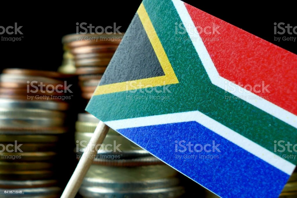 South Africa flag waving with stack of money coins macro stock photo