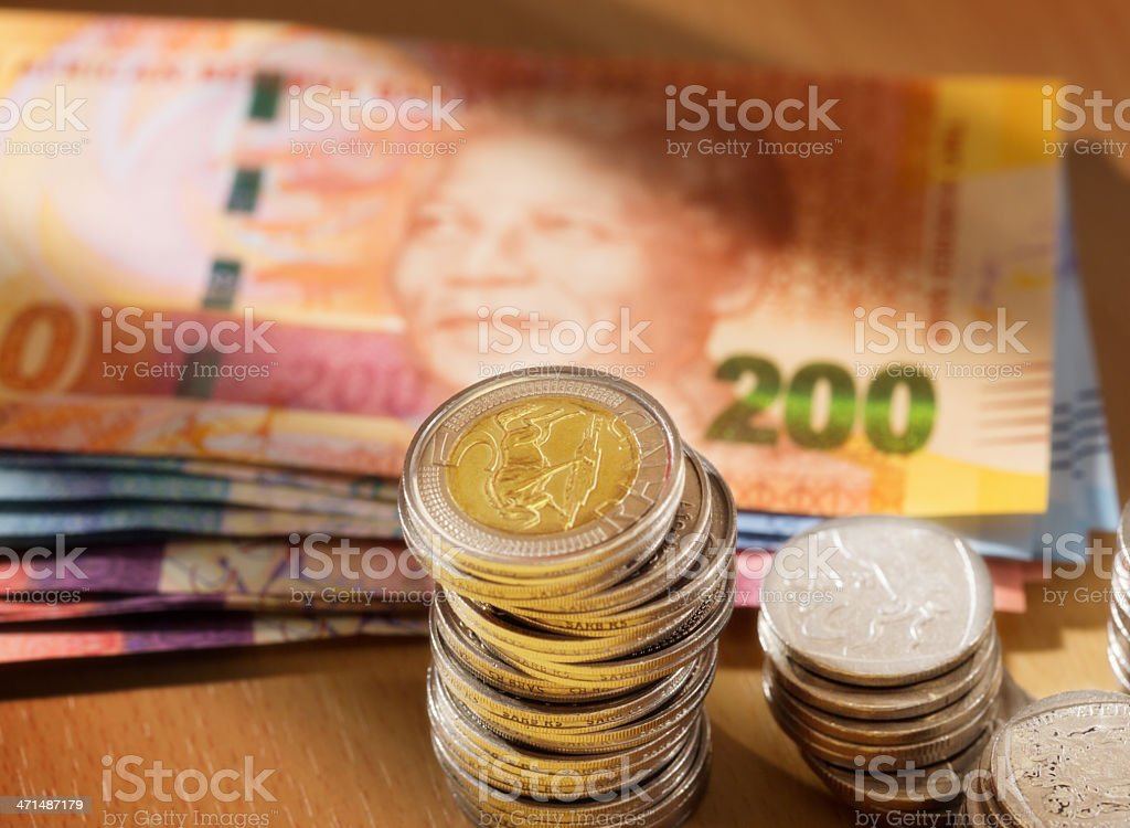 South African coins with new Mandela banknotes behind them stock photo