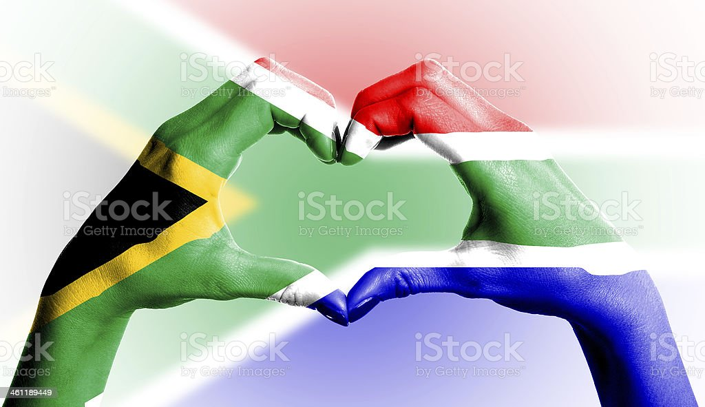 South African flag over heart-shaped human hands on isolated background stock photo