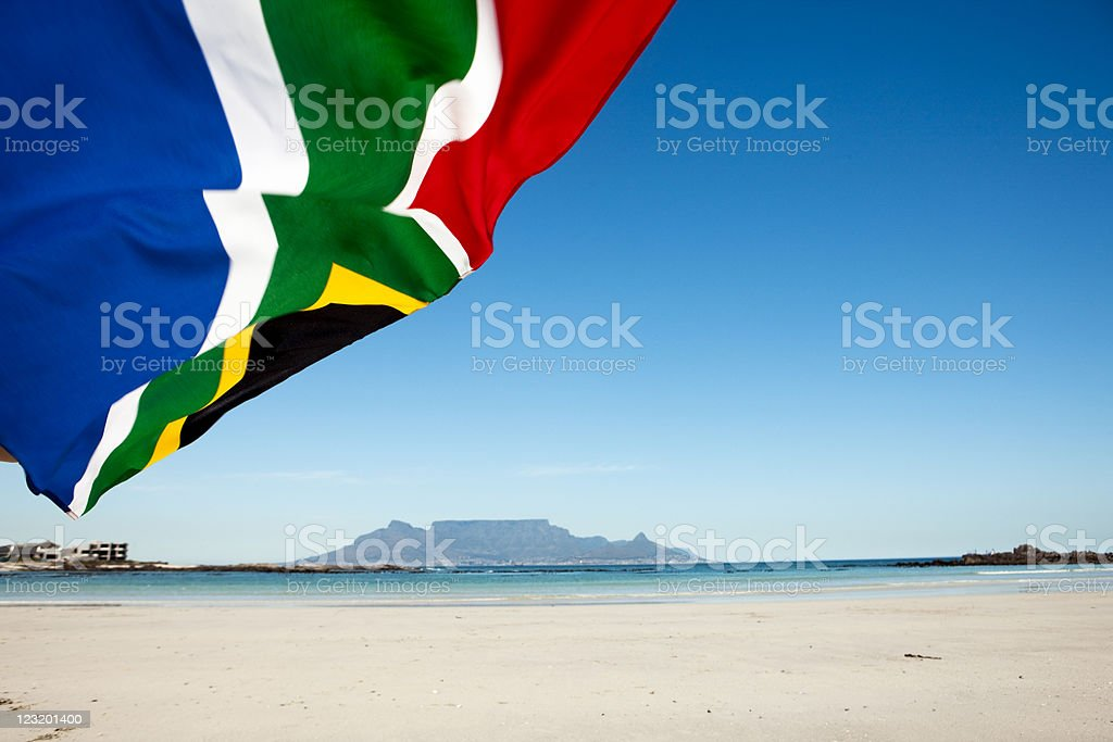 South African flag waves  in front of Table Mountain stock photo