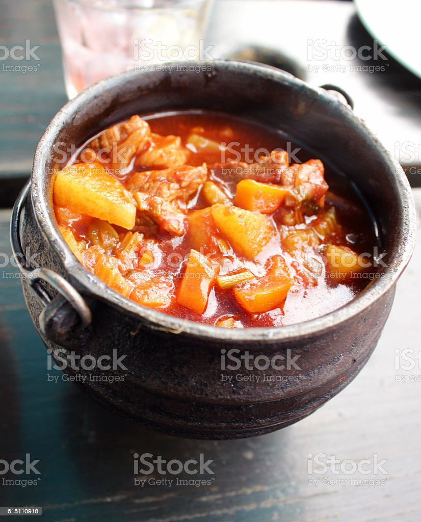 South African potjiekos stew in Iron pot - Stock image stock photo