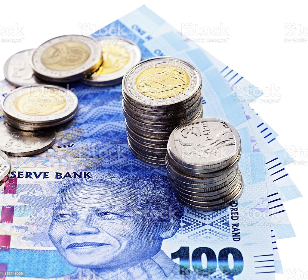 South African silver coins stacked on One Hundred Rand banknotes royalty-free stock photo
