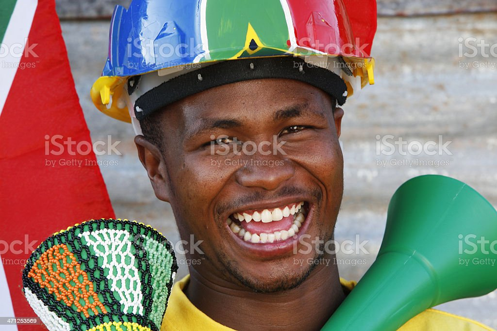 South African soccer supporter and vuvuzela stock photo