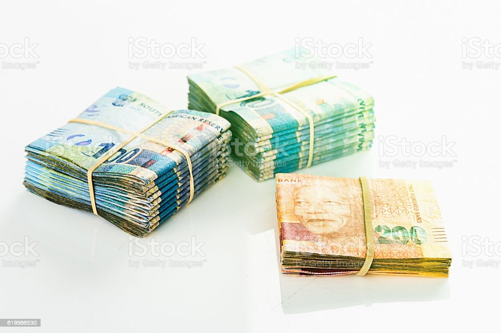 South African spending money: bundles of neatly folded banknotes stock photo