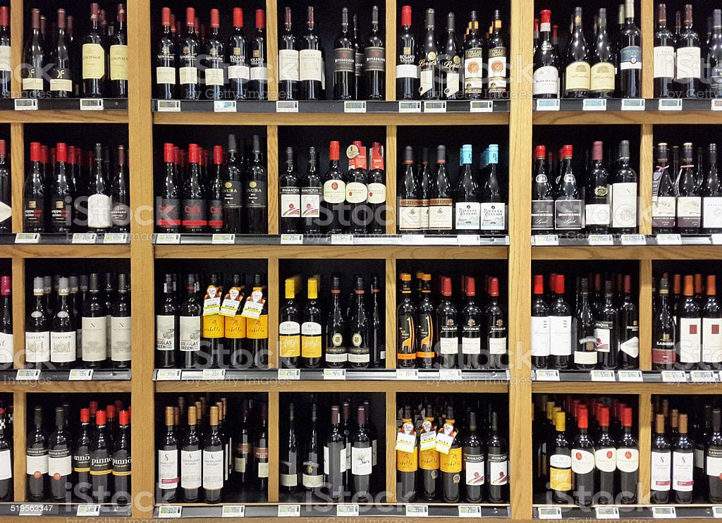 South African wines stacked on shelves in liquor store stock photo
