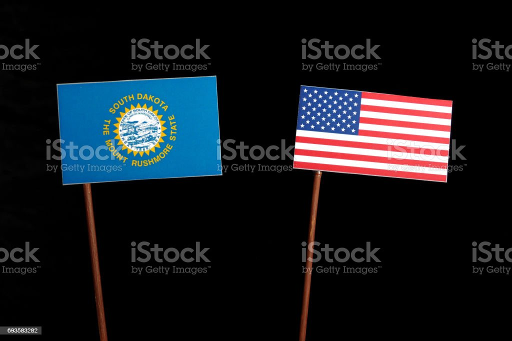 South Dakota flag with USA flag isolated on black background stock photo
