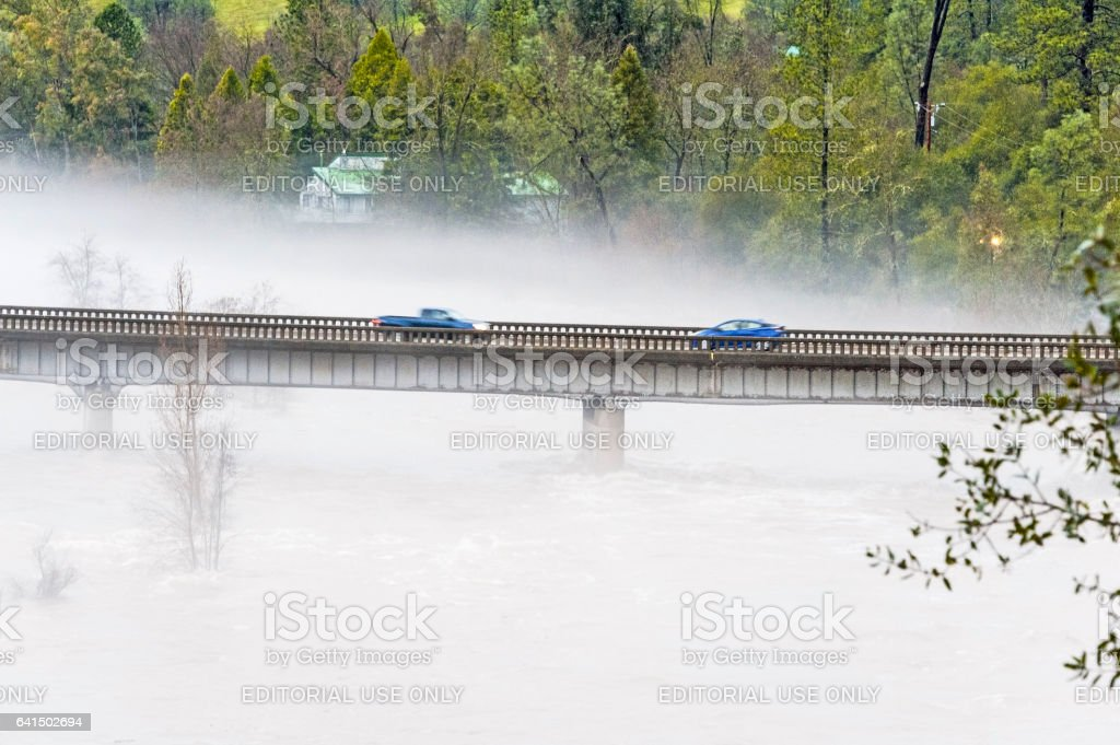 South Fork American River Flooding Bridge and Home with Fog stock photo